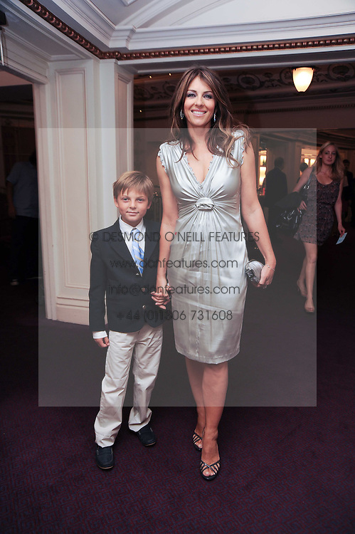ELIZABETH HURLEY and her son DAMIAN at the Yota launch of Mikhailovsky Ballet's Swan Lake held at the London Coliseum, St.Martin's Lane, London on 13th July 2010.