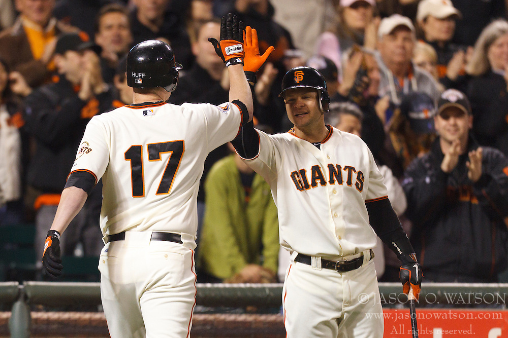 May 11, 2011; San Francisco, CA, USA;  San Francisco Giants first baseman Aubrey Huff (17) is congratulated by center fielder Cody Ross (13) after hitting a home run against the Arizona Diamondbacks during the fifth inning at AT&T Park.
