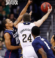 SOUTH BEND, IN - JANUARY 12: Omar Calhoun #21 of the Connecticut Huskies defends the shot of Pat Connaughton #24 of the Notre Dame Fighting Irish at Purcel Pavilion on January 12, 2012 in South Bend, Indiana. (Photo by Michael Hickey/Getty Images) *** Local Caption *** Omar Calhoun; Pat Connaughton