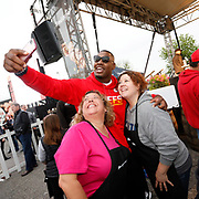 Kansas City Chiefs defensive end Chris Jones takes a selfie with participants as they celebrate Smithfield setting the Guinness World Records title for Largest grilling lesson on Thursday, April 27, 2017, in Kansas City, Mo. Photo by Colin E. Braley for Smithfield