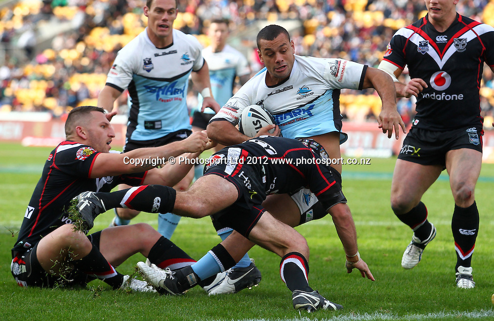 Jayson Bukuya of the Sharks is tackled close to the Warriors tryline during the NRL game, Vodafone Warriors v Cronulla Sharks, Mt Smart Stadium, Auckland, Sunday 5 August  2012. Photo: Simon Watts /photosport.co.nz