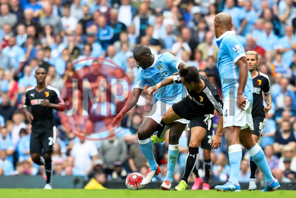 Watford's Jose Manuel Jurado tackles Yaya Toure of Manchester City  - Mandatory byline: Matt McNulty/JMP - 07966386802 - 29/08/2015 - FOOTBALL - Etihad Stadium -Manchester,England - Manchester City v Watford - Barclays Premier League