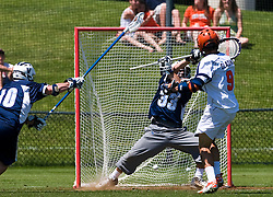 Virginia Cavaliers A Danny Glading (9) beats Villanova Wildcats Goalkeeper Andrew DiLoreto (33) for a goal.  The #5 ranked Virginia Cavaliers defeated the #19 ranked Villanova Wildcats 18-6 in the first round of the 2008 NCAA Men's Lacrosse Tournament the University of Virginia's Klockner Stadium in Charlottesville, VA on May 10, 2009.