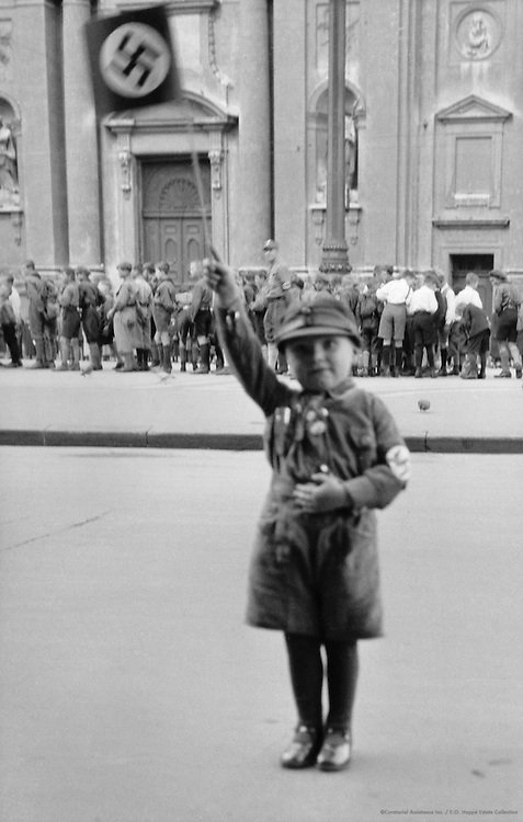 Child with Nazi Flag Giving the Hitler Greeting, Munich, 1933