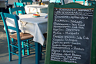 A chalkboard menu at a taverna in Kamares, Sifnos, The Cyclades, Greek Islands, Greece, Europe
