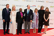 Prince Charles and Princess Camilla of Bourbon of the two Sicilies, Desmond Tutu, Prince Albert II of Monaco, Dawn Engle, Ivan Suvanjieff and Claudia Abate-Debat attend a photocall during the 54th Monte-Carlo Television Festival at Grimaldi Forum on June 8, 2014 in Monte-Carlo, Monaco.