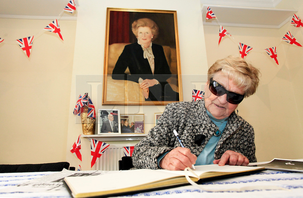 © Licensed to London News Pictures 10/04/2013.Jane Jarrard, from Frierns Barnet, signs the condolence book following the death of Margaret Thatcher, at Finchley Conservatives Association in north London..London, UK.Photo credit: Anna Branthwaite