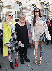 Jenni Murray with fashionistas Andy Coppins (left) and Lisa Reynolds, outside the Somerset House tent  at London Fashion Week , Sunday, 16th February 2014. Picture by Stephen Lock / i-Images