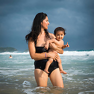 Lizzette Arg&uuml;ello Rocha and her 10-month-old daughter Indra enjoy a day at the Pacific Ocean.<br />