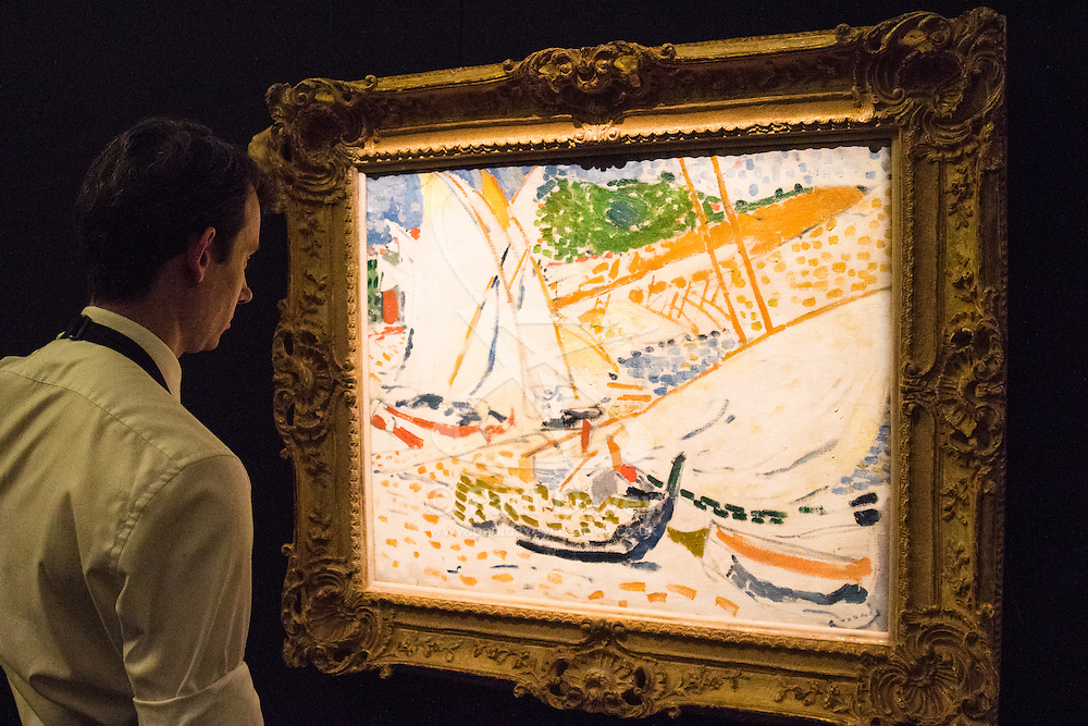 Sotheby's, London, June 19th 2015. International auctioneers Sotheby's gears up to holding what they say is London's highest valued auction of contemporary artworks, to be held on June 24th 2015 where the combined artworks are anticipated to bring in as much as £203 million. PICTURED: A Sotheby's gallery technician examines Andre Derain's Voiliers a Colloure, an oil on canvas from 1905, which is expected to fetch £2-3 million.  // Payment/Licencing/Contact details: Paul@pauldaveycreative.co.uk Tel: 07966016296
