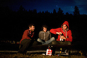 Blind Pilot vibes player Ian Krist, left, lead singer Israel Nebeker, cneter, and drummer Ryan Dobrowski, right, enjoy beers behind the Peg House after the show and a long day riding on Highway 101 in Leggett, CA on September 18, 2008.
