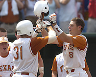Texas third basemen David Maroul (R) celebrates at home plate with Longhorn Taylor Teagarden (31) after hitting a three run homer in the bottome of the sixth inning.  Texas defeated Florida 6-2 for the National Championship at the College World Series at Rosenblatt Stadium in Omaha, Nebraska on June 26, 2005.
