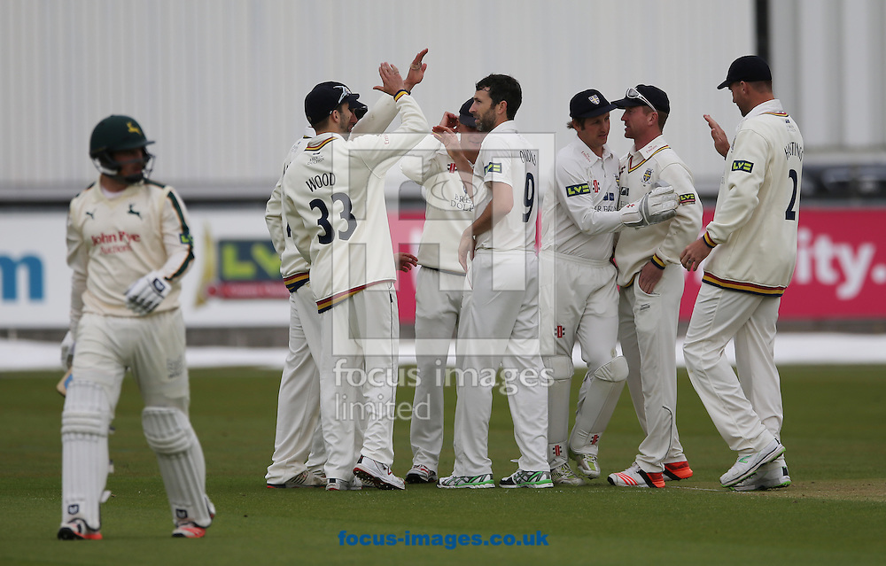 Graham Onions (9) of Durham is congratulated on the wicket of Steven Mullaney (l) of Nottinghamshire during the LV County Championship Div One match at Emirates Durham ICG, Chester-le-Street<br /> Picture by Simon Moore/Focus Images Ltd 07807 671782<br /> 10/05/2015