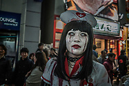 Young woman as part of the marching dead during the Halloween celebration in Shibuya, Tokyo.