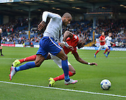 Bury Striker Leon Clarke is fouled and in the area and wins a penalty during the Sky Bet League 1 match between Bury and Coventry City at Gigg Lane, Bury, England on 26 September 2015. Photo by Mark Pollitt.