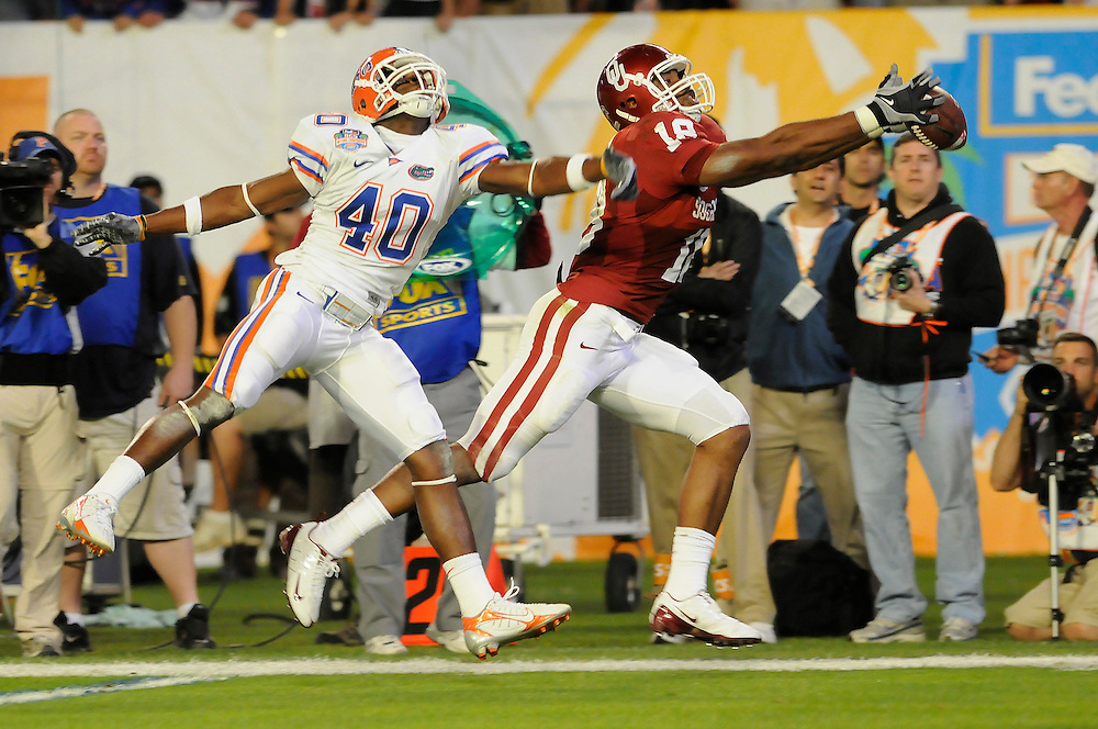 January 8, 2009: Jermaine Gresham of the Oklahoma Sooners reaches for a pass as Brandon Hicks of the Florida Gators defends during the NCAA football game between the Florida Gators and the Oklahoma Sooners in the 2009 BCS National Championship Game. The Gators defeated the Sooners 24-14.