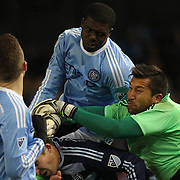 Goalkeeper Luis Marín, Sporting KC, punches clear from Kwame Watson-Siriboe, NYCFC, during the New York City FC Vs Sporting Kansas City, MSL regular season football match at Yankee Stadium, The Bronx, New York,  USA. 27th March 2015. Photo Tim Clayton