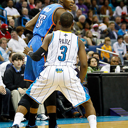 January 24,  2011; New Orleans, LA, USA; Oklahoma City Thunder small forward Kevin Durant (35) is guarded by New Orleans Hornets point guard Chris Paul (3) during the second half at the New Orleans Arena. The Hornets defeated the Thunder 91-89. Mandatory Credit: Derick E. Hingle