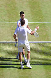LONDON, ENGLAND - Friday, July 4, 2014: Novak Djokovic (SRB) embraces Grigor Dimitrov (BUL) after winning the Gentlemen's Singles Semi-Final match 6-3, 3-6, 7-6 (2), 7-6 (7) on day eleven of the Wimbledon Lawn Tennis Championships at the All England Lawn Tennis and Croquet Club. (Pic by David Rawcliffe/Propaganda)