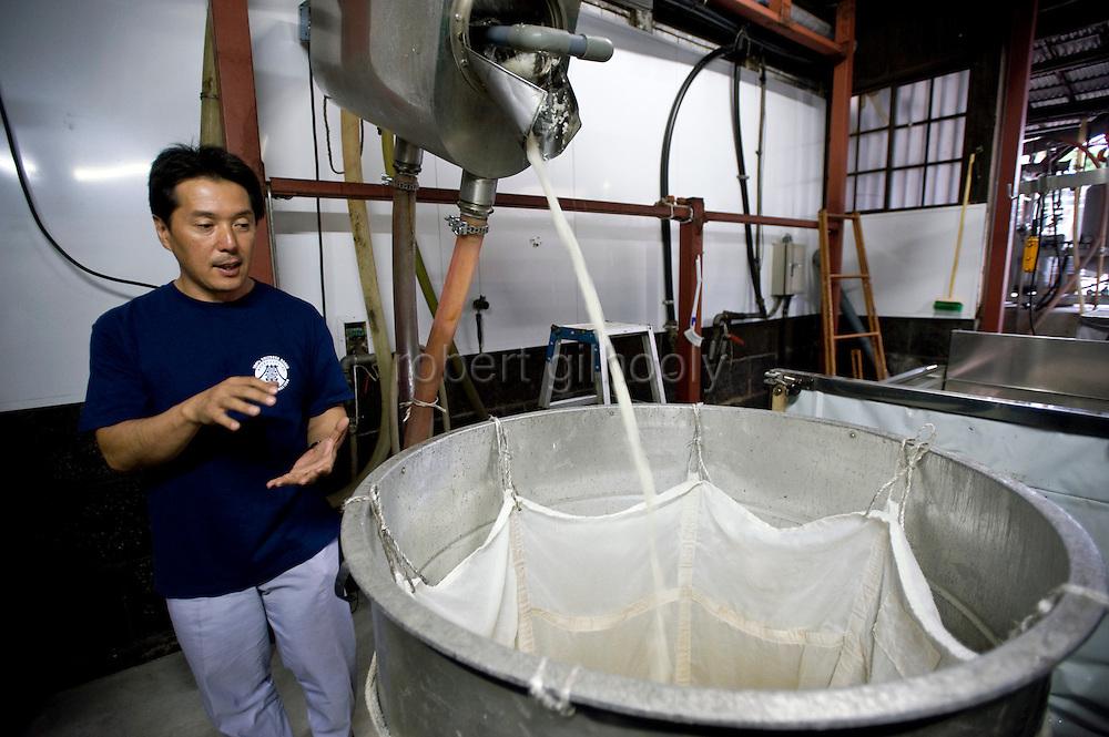 Shinichi Sei, president of Fuji-nishiki Sake Brewery explains the brewing process at the brewery in Fujinomiya, Shizuoka Prefecture Japan on 02 Oct. 2012.  Photographer: Robert Gilhooly