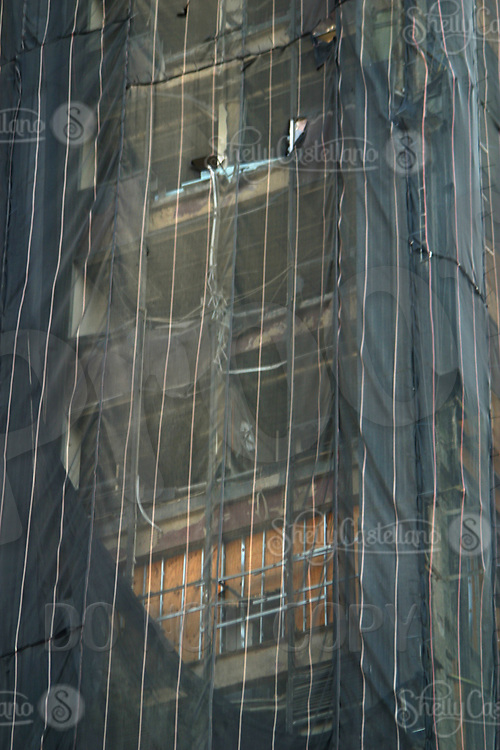 Aug 16, 2002; New York, NY, USA; Protective netting falls apart almost one year later after the attacks on the World Trade Center.  Surrounding buildings got boarded up and are awaiting plans for the future.  Mandatory Credit: Photo by Shelly Castellano/ZUMA Press. (©) Copyright 2002 by Shelly Castellano