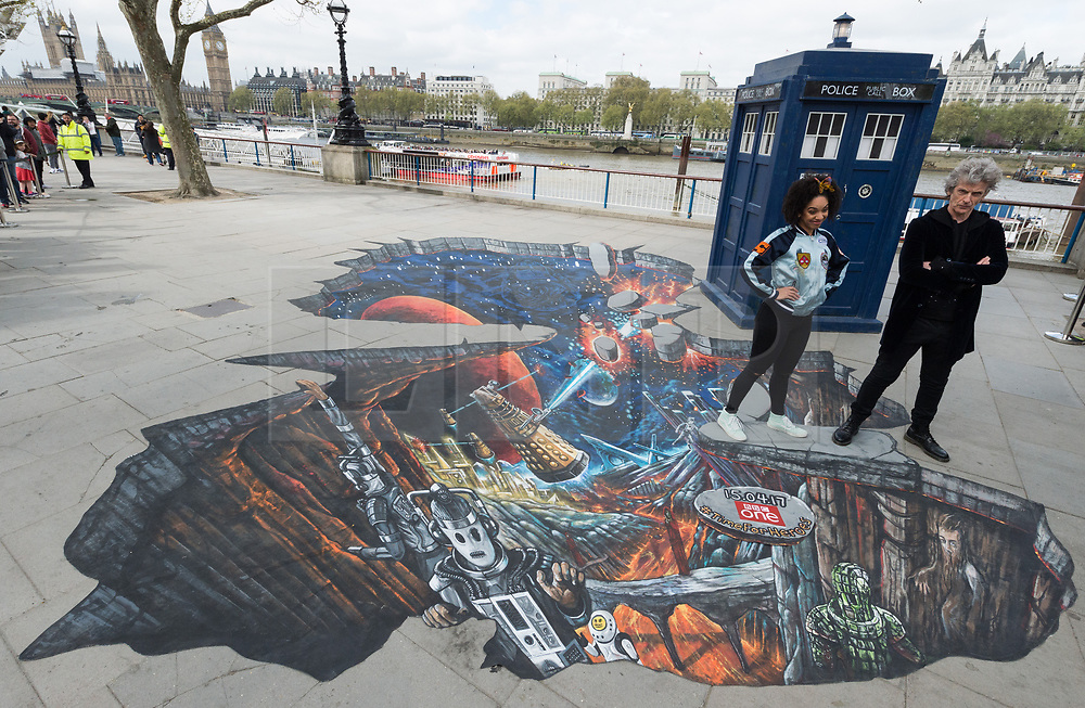 © Licensed to London News Pictures. 12/04/2017. Actress Pearl Mackie who plays new companion Bill Potts  and Actor Peter Capaldi who plays Dr Who stand on 3D Alien Landscape painting to celebrate new TV series of Dr Who. London, UK. Photo credit: Ray Tang/LNP