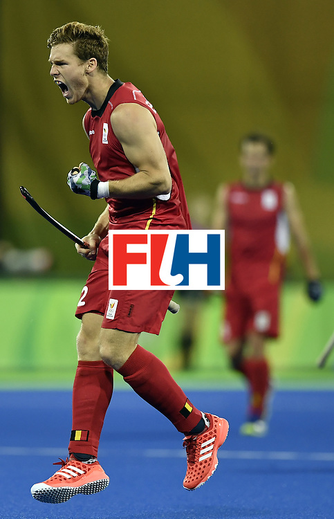 Belgium's Gauthier Boccard celebrates after scoring a goal during the men's Gold medal field hockey Belgium vs Argentina match of the Rio 2016 Olympics Games at the Olympic Hockey Centre in Rio de Janeiro on August 18, 2016. / AFP / PHILIPPE LOPEZ        (Photo credit should read PHILIPPE LOPEZ/AFP/Getty Images)