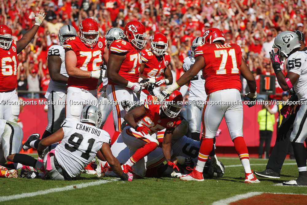 October 13, 2013: Kansas City Chiefs running back Jamaal Charles (25) gets up after scoring a touchdown on a 2 yard run in the 3rd quarter of the Kansas City Chiefs 24-7 victory over the Oakland Raiders at Arrowhead Stadium in Kansas City, Missouri.