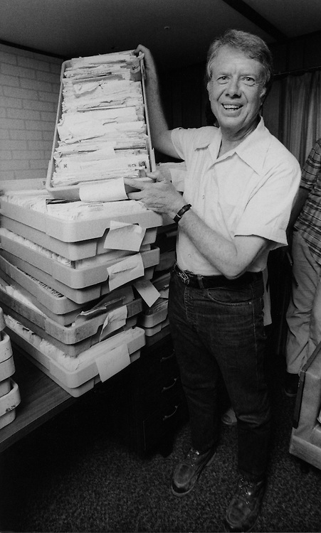 Former Georgia governor and now presidential candidate Jimmy Carter with  mail from campaign supporters shortly after winning the Iowa Primary.