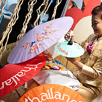 Milan, Italy - February  17: A Thai woman paints on umbrellas at BIT International Tourism Exchange on february 17, 2012 in Milan, Italy.