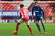 AFC Wimbledon midfielder Tom Soares (19) battles for possession with Charlton Athletic midfielder Tarique Fosu (11) during the EFL Sky Bet League 1 match between Charlton Athletic and AFC Wimbledon at The Valley, London, England on 15 December 2018.
