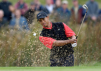 Photo: Daniel Hambury.<br />WGC American Express Championship, The Grove. 01/10/2006.<br />Tiger Woods chips out of the bunker onto the 12th green.