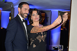 ROBERT PIRES and his wife JESSICA LEMARIE at the Chain of Hope Gala Ball held at The Grosvenor House Hotel, Park Lane, London on 18th November 2016.