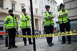 "© Licensed to London News Pictures . 12/06/2013 . London , UK . Police at the scene . A demonstration organised by a coalition of anti-militarist groups , including Sussex Stop G8 , Smash EDO and Disarm DSEI , at BAE Systems office on Carlton Gardens , London , today (Wednesday 12th June) . This as part of a series of "" Stop G8 "" anti capitalist protests in London this week ahead of Britain hosting the 39th G8 summit on 17th/18th June at the Lough Erne Resort , County Fermanagh , Northern Ireland , next week .  Photo credit : Joel Goodman/LNP"