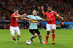 Radja Nainggolan of Belgium goes down under the challenge of Ashley Williams of Wales  - Mandatory by-line: Joe Meredith/JMP - 01/07/2016 - FOOTBALL - Stade Pierre Mauroy - Lille, France - Wales v Belgium - UEFA European Championship quarter final
