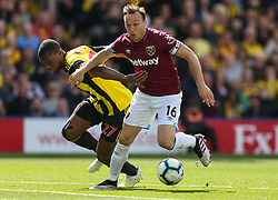 West Ham United's Mark Noble and Watford's Christian Kabasele during the Premier League match at Vicarage Road, Watford.