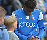 Devante Cole stops and signs a fans programme before the Sky Bet League 1 match between Oldham Athletic and Bradford City at Boundary Park, Oldham, England on 5 September 2015. Photo by Mark Pollitt.