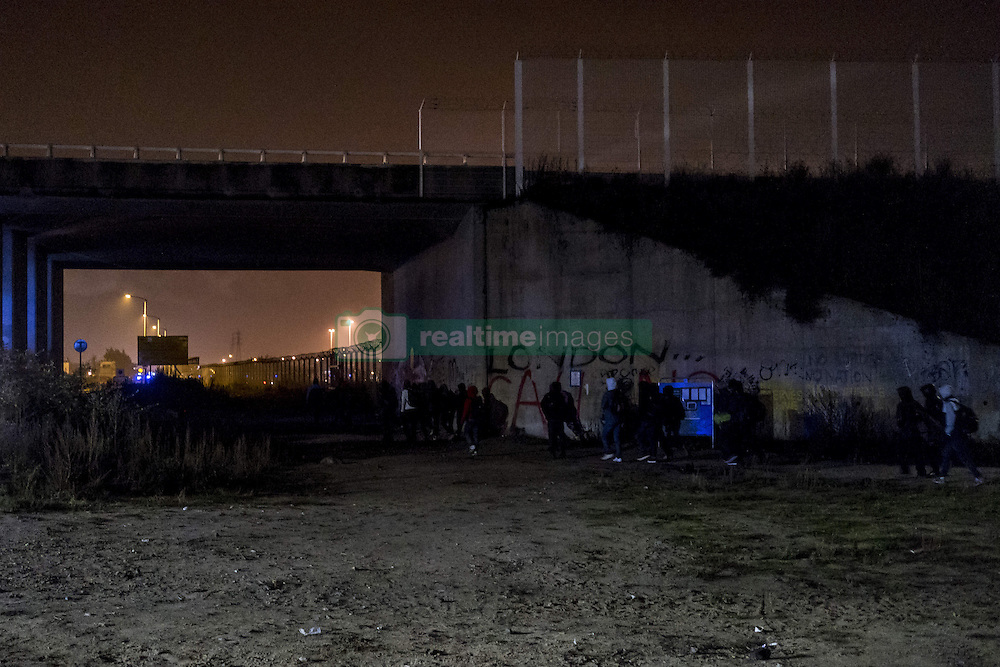 October 24, 2016 - Calais, France - The first refugees arrive early and wait in front of the hangar distribution of refugees with their luggage in Calais, France on october 24, 2016. The dismantling of the jungle began Monday morning. Refugees come accompanied by the associations to the starting center ''C.A.O.''. Police frames the device. More than 850 press credentials were distributed. (Credit Image: © Julien Pitinome/NurPhoto via ZUMA Press)