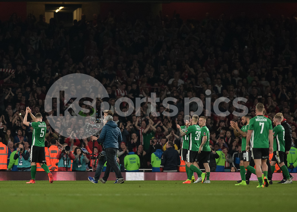 Lincoln City players salute their fans during the The FA Cup sixth round match between Arsenal and Lincoln City at the Emirates Stadium, London, England on 11 March 2017. Photo by Vince Mignott.