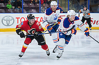 PENTICTON, CANADA - SEPTEMBER 17: Dillon Dube #59 of Calgary Flames stick checks Chad Butcher #65 of Edmonton Oilers on September 17, 2016 at the South Okanagan Event Centre in Penticton, British Columbia, Canada.  (Photo by Marissa Baecker/Shoot the Breeze)  *** Local Caption *** Dillon Dube; Chad Butcher;
