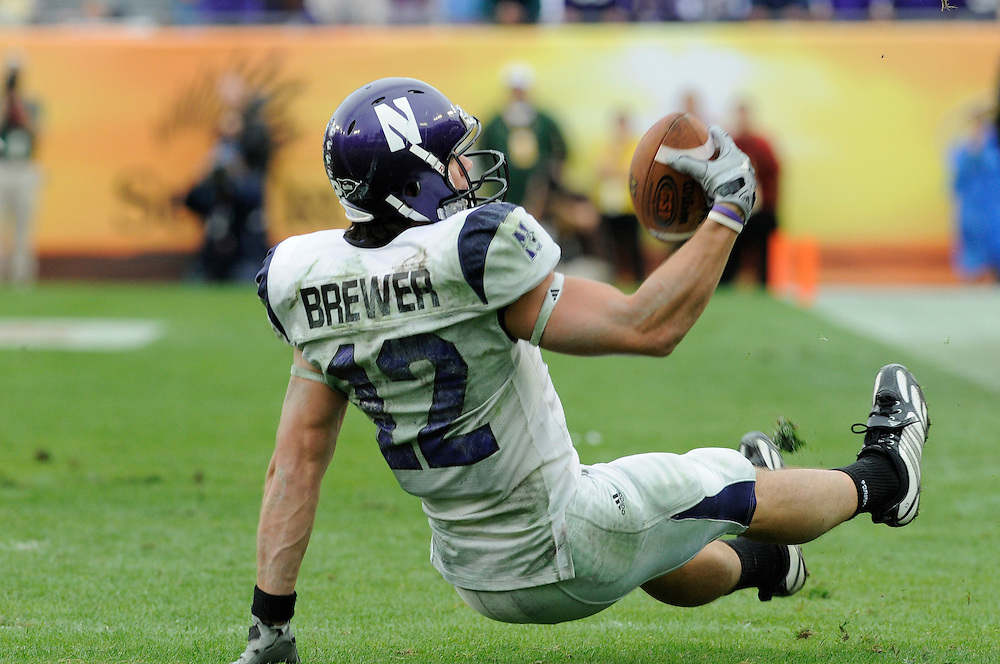 January 1, 2010: Wide receiver Andrew Brewer of the Northwestern Wildcats reaches for a pass during the NCAA football game between the Northwestern Wildcats and the Auburn Tigers in the Outback Bowl. The Tigers defeated the Wildcats 38-35 in overtime.