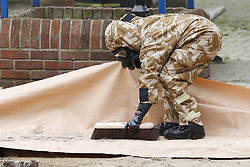 © Licensed to London News Pictures. 24/04/2018. Salisbury, UK. Members of the armed forces work in the area of the Maltings where a bench was earlier removed as the clean up operation begins in Salisbury. Former Russian Spy Sergei Skripal and his daughter Yulia were poisoned using a nerve agent in the city last month. Experts have warned that 'Toxic levels' of the nerve agent novichok could still be present at hot spots around the city. Photo credit: Peter Macdiarmid/LNP