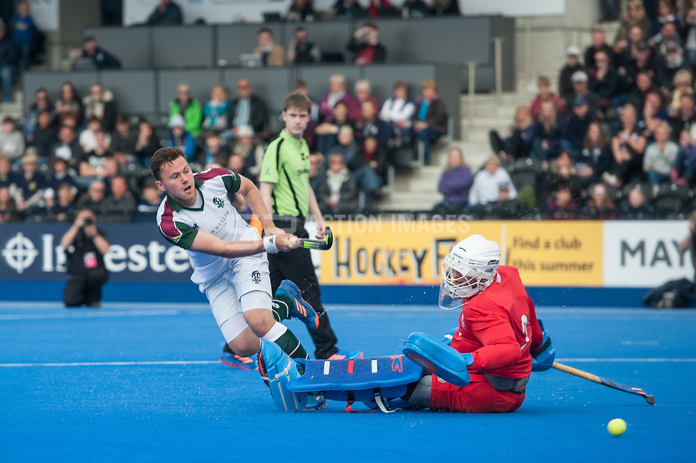 Surbiton's Alan Forsyth gets his shot past James Bailey of Wimbledon in the shoot out. Wimbledon v Surbiton - Men's Hockey League Final, Lee Valley Hockey & Tennis Centre, London, UK on 23 April 2017. Photo: Simon Parker