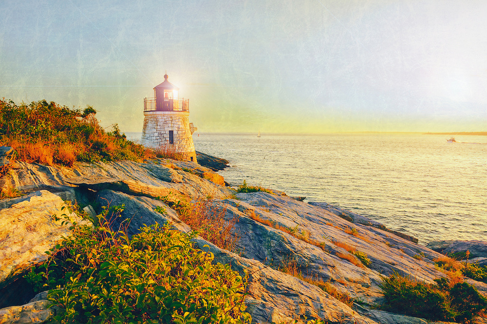 Castle Hill Lighthouse at twilight during the blue hour just before sunset, Newport, Rhode Island, USA with a vintage retro textured feel taken in early September. Mixed media fine art photograph with texture, digital painting and filters added. The beautiful granite tower, completed in 1890, is built right into the cliff face. The original beacon was a kerosene-powered fifth-order Fresnel lens, which was replaced in 1899, and again in 1957 by the current modern plastic lens when the last lighthouse keeper left and Castle Hill light was automated in 1957. With its red beacon, Castle Hill light house is still an active navigational aids for ships in Narragansett Bay heading toward Providence and Newport, RI. The lighthouse stands on land sold to the United States government for $1.00. Although the tower is not open to the public, you may walk right up to it across the cliffs via paths from the Castle Hill Inn, a lovely bed and breakfast with a charming restaurant nearby, and approach the water's edge via a steep stairway.