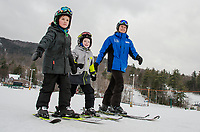 Camden and Noah head towards the Ram Rod Quad lift with their instructor Kaitlyn Kappas for a lesson on Tuesday afternoon.  (Karen Bobotas/for the Laconia Daily Sun)