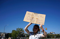 A protestor at Bear Creek High School in Lakewood, Colorado  stands on the street near the school September 25, 2014 as high school students in Colorado's second-largest school district staged a walkout again Thursday to protest proposed changes to a history curriculum that would stress patriotism and discourage civil disobedience. REUTERS/Rick Wilking (UNITED STATES)