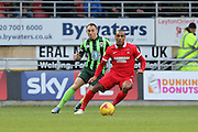 Barry Fuller (Captain) of AFC Wimbledon keeps a close watch on Jay Simpson of Leyton Orient during Sky Bet League 2 match between Leyton Orient and AFC Wimbledon at the Matchroom Stadium, London, England on 28 November 2015. Photo by Stuart Butcher.