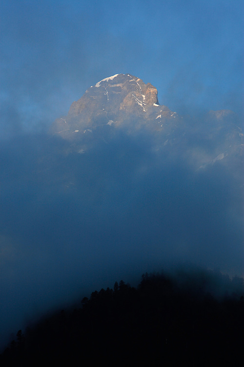 Russia, Caucasus, Teberdinsky Biosphere reserve, forest, mountain, fog and morning light. Near Dombay.