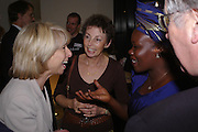 Helen Worth, Carrie Wilkie, Winnie Mccru and Ronnie Wilkie. Cocktail party celebrating Born Free Foundation 21 years anniversary.  Royal Geographical Society, Kensington Gore. 14 march 2005. ONE TIME USE ONLY - DO NOT ARCHIVE  © Copyright Photograph by Dafydd Jones 66 Stockwell Park Rd. London SW9 0DA Tel 020 7733 0108 www.dafjones.com