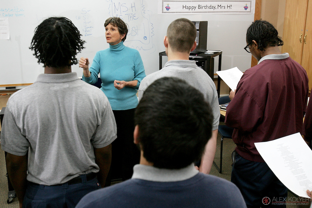 11/10/11 -- Photo by Alex Kolyer -- Red Wing <br /> Bea Hasselmann directs members of the boys choir during a practice session at the Minnesota Correctional Facility in Red Wing. Hasslemann volunteers her time each week as the choir director to some of the young men incarcerated at the facility. She also leads the Metropolitan Boys Choir in Minneapolis, which she founded in 1971.